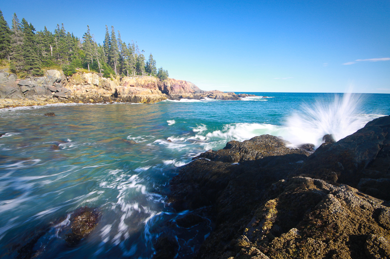 A wave crashes against the rocks in Acadia National Park, Maine.